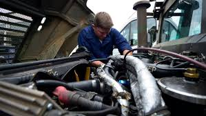Auto Repair technician fixing a vehicle with proper tools
